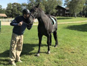 man-kissing-horse-web